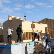 Construction of a wooden house — Stock Photo #9591307