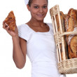 A baker with her bread and a croissant — Stock Photo