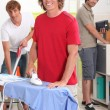 Stock Photo: Guys doing housework