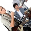 Angled studio shot of a young rock band — Stock Photo