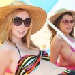 Women with hat on the beach - Stock Photo