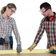 Stock Photo: Couple drilling wood