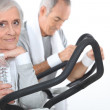 Couple exercising together at the gym — Stock Photo #9594232