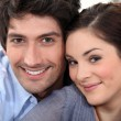 Couple sat hugging at home — Stock Photo #9594495