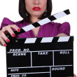 Stock Photo: Womholding up clapperboard