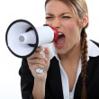 Woman shouting through a loudspeaker — Stock Photo