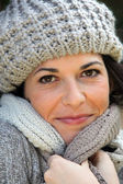 Woman wrapped up in a scarf and hat — Stock Photo