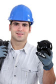 Construction worker holding a piggy bank — Stock Photo
