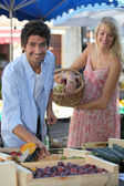 Couple at a market stall — Stock Photo