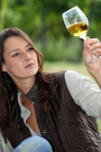 Winemaker watching glass of wine — Stock Photo