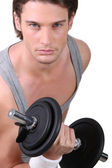 A determined young man working out — Stock Photo
