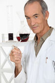Winemaker tasting wine — Stock Photo