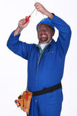 Electrician with faulty wiring — Stock Photo