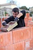 Builder laying blocks — Stock Photo