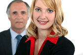 Businessman stood with assistant — Stock Photo