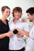 Three friends drinking champagne at new years — Stock Photo