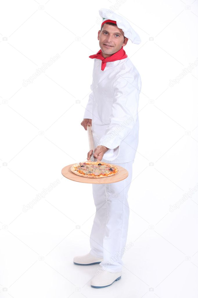 Pizza maker showing off his pizza — Stock Photo #9594950