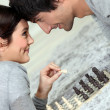 Couple playing chess — Stock Photo #9600496