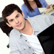 Young man using a laptop — Stock Photo #9601790