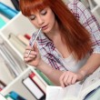 Redhead studying hard for her exams — Stock Photo #9603144