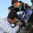 Father and son repairing their motorcycle - Stock Photo