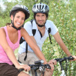 Stock Photo: Couple enjoying bike ride