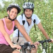 Couple enjoying bike ride - Stock Photo