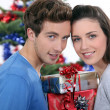Couple with Christmas gifts — Stockfoto