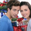 Couple with Christmas gifts — Stock Photo