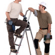 Stock Photo: Two manual workers stood with electric drills