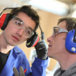 Men wearing ear defenders — Stockfoto