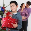 Young family at Christmas — Stock Photo