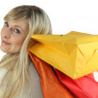 Blond woman carrying shopping bags — Stock Photo #9608190