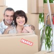 Stock Photo: Couple stood by packed boxes