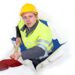 Worker with ax busting through background — Stock Photo