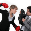 Businesswoman and businessman fighting — Stock Photo