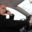 Man on the phone in his car — Stock Photo #9608746