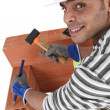 Man using chisel and hammer - Stock Photo