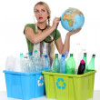 Stock Photo: Portrait of womwith plastic bottles