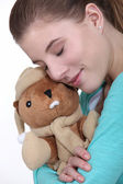 Woman hugging cuddly toy — Stock Photo