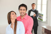 Young couple in their new house — Stock Photo