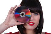 Donna con un disco compatto — Foto Stock
