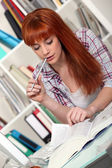 Redhead studying hard for her exams — Stock Photo