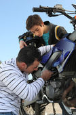 Father and son repairing their motorcycle — Stock Photo