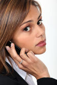Businesswoman with mobile telephone — Stock Photo