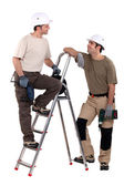 Two manual workers stood with electric drills — Stock Photo