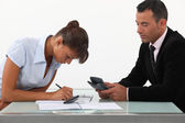 A team of business professionals calculating their budget — Stock Photo