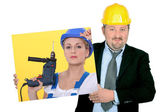 Contractor holding picture of woman building worker — Stock Photo