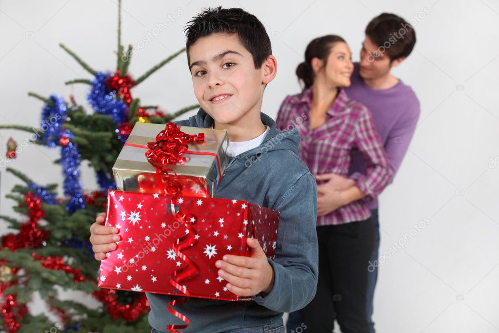 Young family at Christmas — Stock Photo #9607064