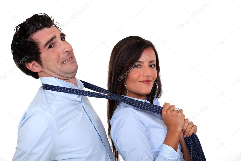 Woman grabbing man by tie  Stock Photo #9607611